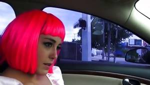 Pink haired slut is posing sexy in a car